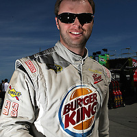 NASCAR Sprint Cup driver Travis Kvapil walks through the garage area, during a NASCAR Daytona 500 practice session at Daytona International Speedway on Wednesday, February 20, 2013 in Daytona Beach, Florida.  (AP Photo/Alex Menendez)