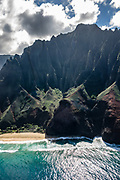 Kalalau Beach & Na Pali Coast sea cliffs seen via helicopter over island of Kauai, Hawaii, USA.