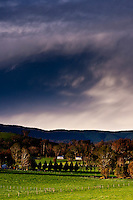Stormy skies rolling across the hills of the Yarra Valley in Victoria, Australia.