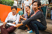 31 MAY 2014 - BANGKOK, THAILAND:  A group of women sing Thai protest, pro-democracy and folk songs in a spontaneous protest against the coup front of a McDonald's in Bangkok. Some McDonald's restaurants in Thailand have become gathering places for anti-coup protestors. The restaurant chain has taken out ads trying to discourage people from protesting in and around the restaurants and put up signs asking people not to protest in the restaurant. Bangkok was mostly quiet Saturday. There were only a few isolated protests against the coup and military government.   PHOTO BY JACK KURTZ