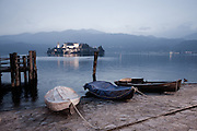 Desaturated image of rowboats on the shore of Lake Orta in Orta San Giulio, Italy. Full color version also available in this gallery.