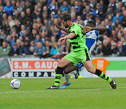 Bristol Rovers' Nathan Blissett tackles Forest Green Rovers's Aarran Racine.- Photo mandatory by-line: Nizaam Jones /JMP - Mobile: 07966 386802 - 03/05/2015 - SPORT - Football - Bristol - Memorial Stadium - Bristol Rovers v Forest Green Rovers - Vanarama Football Conference.