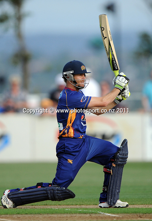 Otago batsman Aaron Redmond hits out during the HRV Twenty20 Cricket match between the Auckland Aces and Otago Volts at Colin Maiden Oval in Auckland, New Zealand on Friday 6 January 2012. Photo: Andrew Cornaga/Photosport.co.nz