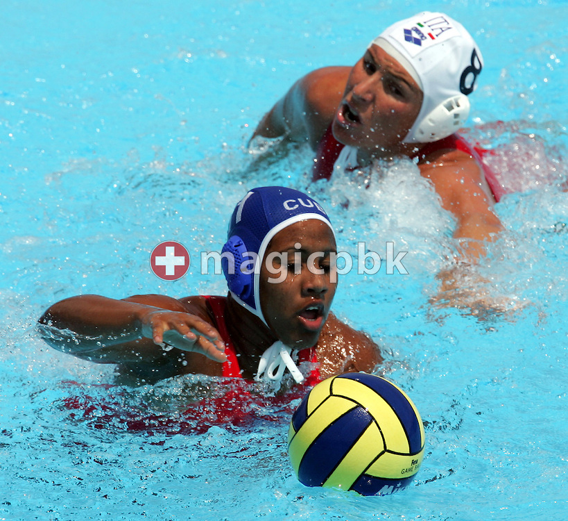 Italy's Cinzia Ragusa (R) chases Cuba's Leyonis Gutierrez (L) during their preliminary round women's water polo match at the FINA World Championships in Montreal, Quebec Tuesday 19 July, 2005. Italy beat Cuba 13-6. (Photo by Patrick B. Kraemer / MAGICPBK)