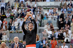 May 12, 2019 - Madrid, Spain - Novak Đoković of Croatia celebrates with the winners trophy after his final win against Stefanos Tsitsipas of Greece during day nine of the Mutua Madrid Open at La Caja Magica in Madrid on 12nd May, 2019. (Credit Image: © Juan Carlos Lucas/NurPhoto via ZUMA Press)