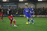 AFC Wimbledon midfielder Dannie Bulman (4) in action during the EFL Sky Bet League 1 match between AFC Wimbledon and Coventry City at the Cherry Red Records Stadium, Kingston, England on 14 February 2017. Photo by Stuart Butcher.