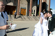Brooklyn, N.Y.  The wedding ceremony of Christine Neve and Vincent Brace at Saints Simon and Judes R.C. Church on Ave T. Kissing. outside the church after the ceremony.