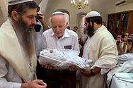 A new born boy's Brit Milla (circumcision) ceremony in Hebron's Jewish community.<br /> Hebron, Israel. 05/11/2007