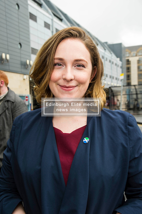 Pictured: Sarah Beattie-Smith<br /> <br /> Scottish Green Party co-convener Patrick Harvie and Scottish Greens infrastructure and transport spokeswoman Sarah Beattie-Smith met bus travellers at a busy intersection in Edinburgh as part of the party's Better Bus campaign <br /> Ger Harley   EEm 5 April 2016