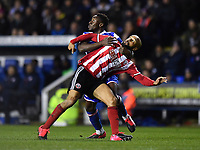 Football - 2019 / 2020 Emirates FA Cup - Fifth Round: Reading vs. Sheffield United<br /> <br /> Sheffield United's David McGoldrick battles for possession with Reading's Andy Yiadom, at the Madejski Stadium.<br /> <br /> COLORSPORT/ASHLEY WESTERN