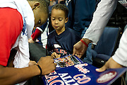 Jaydon Johnson (5) collects autographs from the Allen High School's football state championship team after their community celebration at the Allen Event Center on Wednesday, January 30, 2013 in Allen, Texas. (Cooper Neill/The Dallas Morning News)