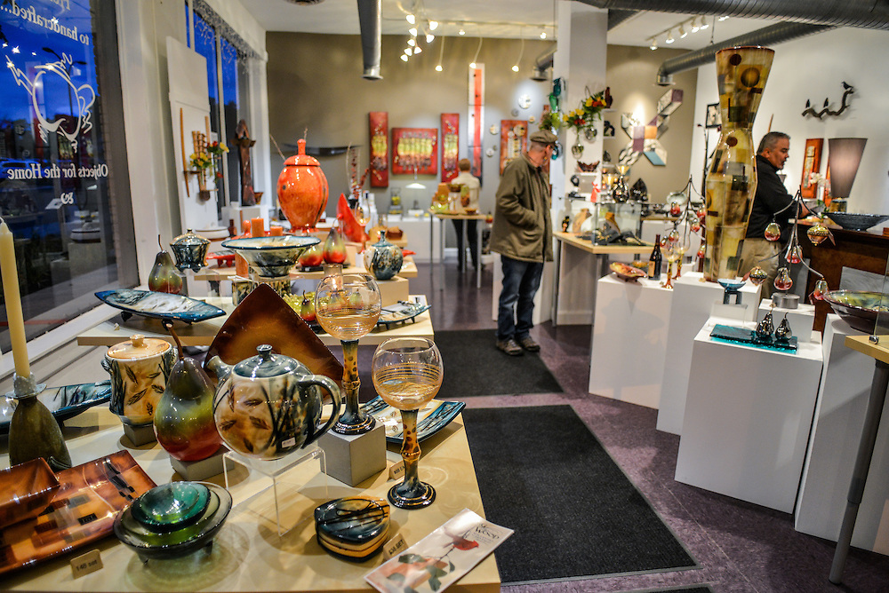Displays of items for sale and guests shopping at Zeber-Martell Clay Studio and Art Gallery.