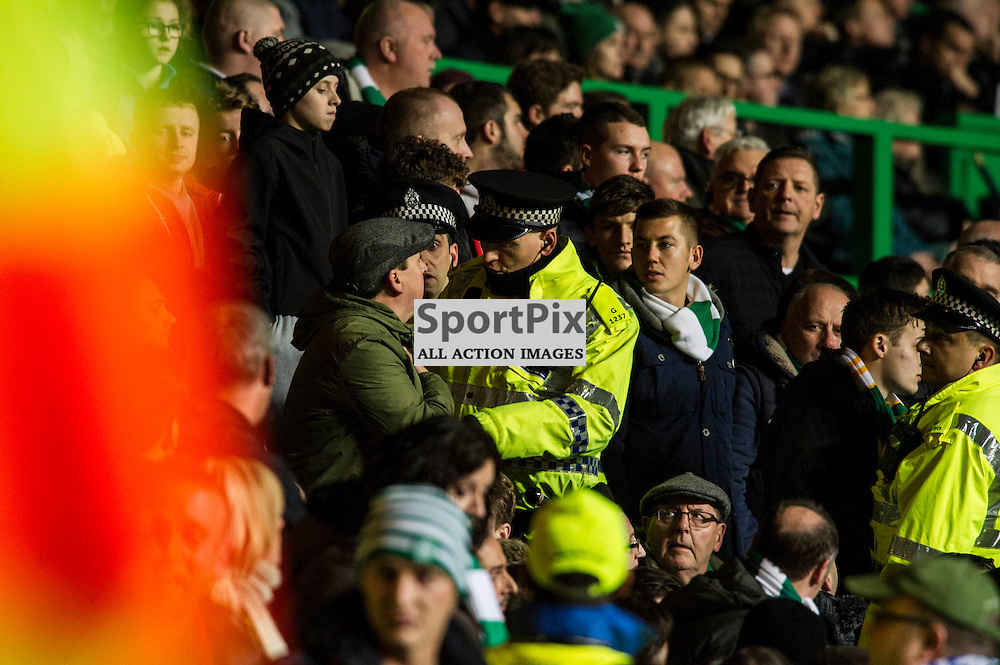 The police encourage a fan to move seats<br /> <br /> as Celtic host Ajax at Parkhead in the Europa League.<br /> &copy; Ger Harley/ SportPix.org.uk 26 November 2015