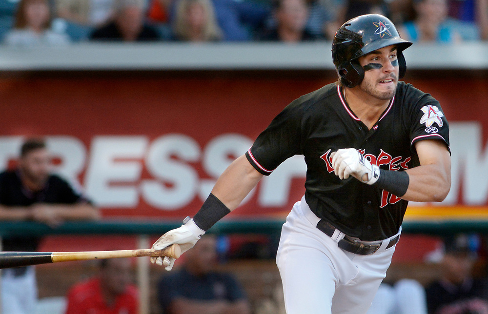 gbs061317p/SPORTS -- The Isotopes' Mike Tauchman hits a two runs on his third inning triple during the game against Fresno in Isotopes Park on Tuesday, June 13, 2017. (Greg Sorber/Albuquerque Journal)
