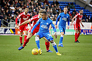 Peterborough Utd midfielder Siriki Dembélé (10) shields the ball during the EFL Sky Bet League 1 match between Peterborough United and Scunthorpe United at London Road, Peterborough, England on 1 January 2019.