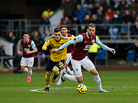 Football - 2019 / 2020 Premier League - Burnley vs. Arsenal<br /> <br /> Jay Rodriguez of Burnley breaks through midfield with Mesut Ozil of Arsenal, at Turf Moor.<br /> <br /> <br /> COLORSPORT/ALAN MARTIN