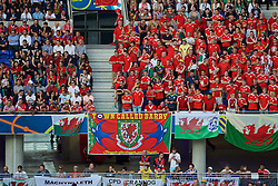 """LYON, FRANCE - Wednesday, July 6, 2016: Wales supporters with a banner """"A town called Barry"""" during the UEFA Euro 2016 Championship Semi-Final match against Portugal at the Stade de Lyon. (Pic by Paul Greenwood/Propaganda)"""