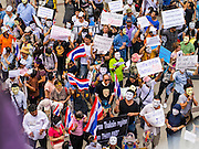 "02 JUNE 2013 - BANGKOK, THAILAND:   A crowd of anti-government protesters on a plaza in Bangkok. The so called White Mask protesters are strong supporters of the Thai monarchy. About 300 people wearing the Guy Fawkes mask popularized by the movie ""V for Vendetta"" and Anonymous, the hackers' group, marched through central Bangkok Sunday demanding the resignation of Prime Minister Yingluck Shinawatra. They claim that Yingluck is acting as a puppet for her brother, former Prime Minister Thaksin Shinawatra, who was deposed by a military coup in 2006 and now lives in exile in Dubai.   PHOTO BY JACK KURTZ"