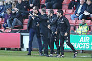 Managers David Artell for Crewe and Danny Cowley for Lincoln protest a refereeing decision with the fourth official during the EFL Sky Bet League 2 match between Crewe Alexandra and Lincoln City at Alexandra Stadium, Crewe, England on 26 December 2018.