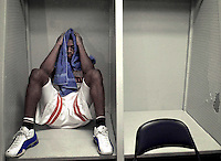 UF freshman Orien Greene sits inside a locker after UF lost to Temple 75-64 in the 2001 men's NCAA Basketball Tournament.