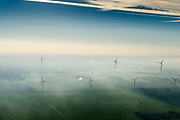 Nederland, Flevoland, Lelystad, 04-11-2018; energielandschap: windmolens in de ochtendnevel, Oostelijk Flevoland, ter hoogte van Maxima centrale en gezien vanaf de IJsselmeerdijk<br /> Energy landscape, wind turbins in the morning haze.<br /> <br /> luchtfoto (toeslag op standaard tarieven);<br /> aerial photo (additional fee required);<br /> copyright&copy; foto/photo Siebe Swart
