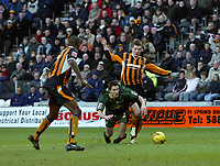 Photo: Andrew Unwin.<br />Hull v Norwich City. Coca Cola Championship. 11/02/2006.<br />Norwich's Adam Drury (C) appeals for a penalty following a challenge from Hull's Ryan France (R).