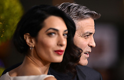 Hollywood star George Clooney was treated in hospital on Tuesday for minor injuries after a scooter accident in Sardinia, Italy on July 10, 2018 ------------ George Clooney and Amal Clooney attend Universal Pictures Hail, Caesar! premiere at Regency Village Theatre on February 1, 2016 in Los Angeles, CA, USA. Photo by Lionel Hahn/ABACAPRESS.COM
