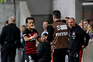SYDNEY, AUSTRALIA - NOVEMBER 22: Western Sydney Wanderers defender Daniel Georgievski (5) goes to the physio to stop his lip bleeding during the round 7 A-League soccer match between Western Sydney Wanderers FC and Melbourne City FC on November 22, 2019 at Bankwest Stadium in Sydney, Australia. (Photo by Speed Media/Icon Sportswire)