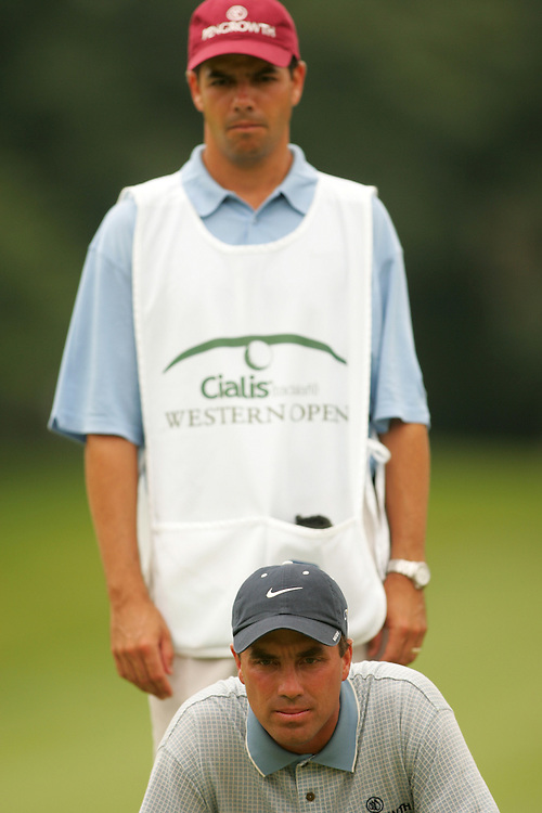 Stephen Ames.Robert Ames ( caddie )..2004 Western Open.Final Round.Cog Hill GC.Lemont, IL.Sunday, July 4 2004..photograph by Darren Carroll