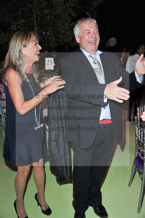 MAYA SCHOENBURG and CHRISTOPHER BIGGINS at a dinner hosted by Cartier in celebration of the Chelsea Flower Show held at Battersea Power Station, 188 Kirtling Street, London SW8 on 23rd May 2011.