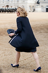 © Licensed to London News Pictures. 12/07/2017. London, UK. UK Home Secretary Amber Rudd picks her hat after it flew off in the wind on the way to Horse Guards Parade to welcome King Felipe VI and Queen Letizia of Spain in London on the first day of State visit of the King and Queen of Spain. Photo credit: Tolga Akmen/LNP
