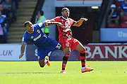 AFC Wimbledon defender Darius Charles (32) and Walsall FC striker Tom Bradshaw (9) tussle during the EFL Sky Bet League 1 match between Walsall and AFC Wimbledon at the Banks's Stadium, Walsall, England on 6 August 2016. Photo by Stuart Butcher.