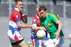 May 5, 2013; Bronx, NY; USA; Leitrim Wayne McKeon (7) carries the ball while being defended by New York Michael O'Regan (3) during the first half at Gaelic Park.