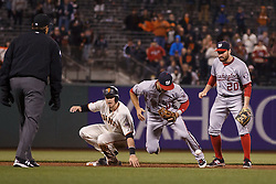 SAN FRANCISCO, CA - JULY 28: Trevor Brown #14 of the San Francisco Giants reaches second base on an error by Danny Espinosa #8 of the Washington Nationals during the ninth inning at AT&T Park on July 28, 2016 in San Francisco, California. The Washington Nationals defeated the San Francisco Giants 4-2. (Photo by Jason O. Watson/Getty Images) *** Local Caption *** Trevor Brown; Danny Espinosa