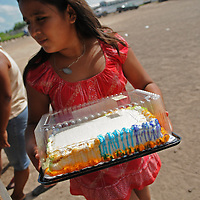 Aug 10, 2010 - Matamoros, Mexico - A young girl walks away from the  Frank Ferree Border Relief groups distribution point at the colonia Leyes De La Reforma near Matamoros with a cake. The group brings down birthday cakes for children and teens who's birthdays are in the month they visit. To receive a cake parents must bring birth certificates to the distribution point. . An Organization which was started by Frank Ferree a former World War I soldier who moved to the Rio Grande Valley in Texas to farm citrus, but ended up devoting his life to helping the poor across the border from his home in Harlingen Texas. Ferree received a Presidential Medal of Freedom from the Former President Reagan and was nominated for a Nobel Peace Prize. .(Credit Image: © Josh Bachman/ZUMA Press)