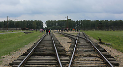 Rail tracks leading to the platform where the selection process took place at the Auschwitz-Birkenau Nazi concentration camps in Auschwitz, Poland on September 3, 2017. Auschwitz concentration camp was a network of German Nazi concentration camps and extermination camps built and operated by the Third Reich in Polish areas annexed by Nazi Germany during WWII. It consisted of Auschwitz I (the original camp), Auschwitz II–Birkenau (a combination concentration/extermination camp), Auschwitz II–Monowitz (a labor camp to staff an IG Farben factory), and 45 satellite camps. In September 1941, Auschwitz II–Birkenau went on to become a major site of the Nazi Final Solution to the Jewish Question. From early 1942 until late 1944, transport trains delivered Jews to the camp's gas chambers from all over German-occupied Europe, where they were killed en masse with the pesticide Zyklon B. An estimated 1.3 million people were sent to the camp, of whom at least 1.1 million died. Around 90 percent of those killed were Jewish; approximately 1 in 6 Jews killed in the Holocaust died at the camp. Others deported to Auschwitz included 150,000 Poles, 23,000 Romani and Sinti, 15,000 Soviet prisoners of war, 400 Jehovah's Witnesses, and tens of thousands of others of diverse nationalities, including an unknown number of homosexuals. Many of those not killed in the gas chambers died of starvation, forced labor, infectious diseases, individual executions, and medical experiments. In 1947, Poland founded a museum on the site of Auschwitz I and II, and in 1979, it was named a UNESCO World Heritage Site. Photo by Somer/ABACAPRESS.COM