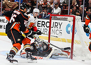 Anaheim Ducks goalie John Gibson (R) makes a save during a 2017-2018 NHL hockey game against Calgary Flames in Anaheim, California, the United States, on Oct. 9, 2017.  Calgary Flames won 2-0. (Xinhua/Zhao Hanrong)