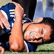 Eduin Munguia, of Anaheim, California, in pain on the ground while a team mate consoles him during a soccer game on November 4, 2016, at Fullerton College, in Fullerton, California. Golden West won 2-0 against Fullerton College.<br /> <br /> Carolyn Rogers/ SSA