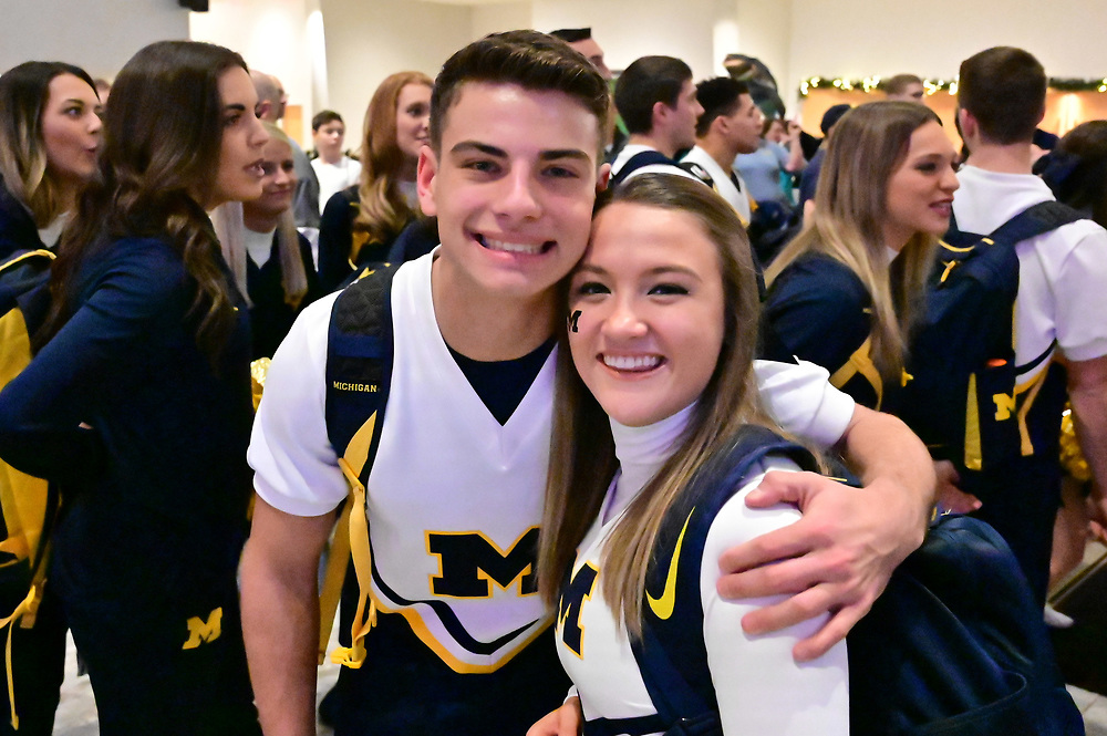 University of Michigan cheerleaders and spirit team members participate in a football FanFest at the Marriott Marquis during preparations for the Chick-fil-A Peach Bowl, December 28, 2018, in Atlanta. Michigan will face Florida in the Chick-fil-A Peach Bowl at Mercedes-Benz Stadium on December 29, 2018. (David Tulis via Abell Images for Chick-fil-A Peach Bowl)