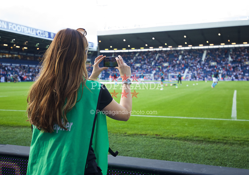 WEST BROMWICH, ENGLAND - Monday, August 10, 2015: An official photographer uses a camera phone during the Premier League match at the Hawthorns. (Pic by David Rawcliffe/Propaganda)