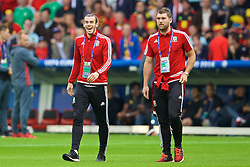 LILLE, FRANCE - Friday, July 1, 2016: Wales' Gareth Bale and Sam Vokes walk onto the pitch before the UEFA Euro 2016 Championship Quarter-Final match against Belgium at the Stade Pierre Mauroy. (Pic by David Rawcliffe/Propaganda)