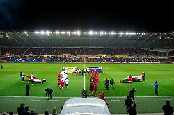 SWANSEA, WALES - Tuesday, March 26, 2013: Wales and Croatia players walk out before the 2014 FIFA World Cup Brazil Qualifying Group A match at the Liberty Stadium. (Pic by Tom Hevezi/Propaganda)