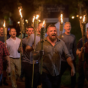 CHARLOTTESVILLE,VA-AUG11:Chanting &ldquo;White lives matter!&rdquo; &ldquo;You will not replace us!&rdquo; and &ldquo;Jews will not replace us!&rdquo; several hundred white nationalists and white supremacists carrying torches marched in a parade through the University of Virginia campus last night.<br /> Beginning a little after 9:30 p.m., the march lasted 15 to 20 minutes before ending in skirmishing when the marchers were met by a small group of counterprotesters at the base of a statue of Thomas Jefferson, the university&rsquo;s founder. (Photo by Evelyn Hockstein/For The Washington Post)