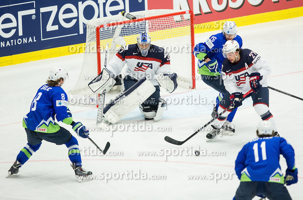 Ziga Jeglic of Slovenia and Jan Urbas of Slovenia vs Justin Faulk of USA and Connor Hellebuyck of USA during Ice Hockey match between Slovenia and USA at Day 10 in Group B of 2015 IIHF World Championship, on May 10, 2015 in CEZ Arena, Ostrava, Czech Republic. Photo by Vid Ponikvar / Sportida