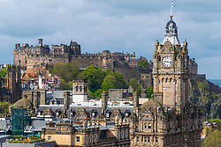 Skyline view of Edinburgh Castle and clocktower of Balmoral Hotel in Edinburgh, Scotland, UK