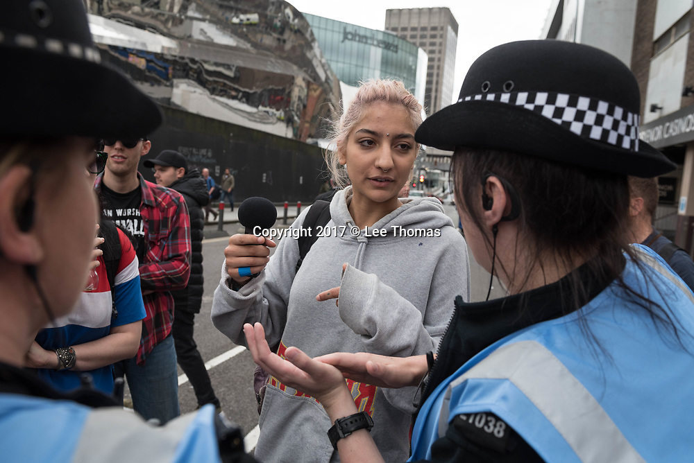 Birmingham, West Midlands, UK. 24th June 2017. Pictured: Saira Zafar wearing grey top.  / Up to two hundred Britain First supporters take to the streets of the Birmingham to protest against muslims living in the area and beyond in the UK.  Scores of police formed a barrier between the far-right supporters and a vocal anti-fascist group consisting of  Birmingham Unite Against Fascism, trades unions, the muslim community and Love Music Hate Racism. The Britain First demonstration comes at a time when thousands of muslims take to the shops of Birmingham to prepare for  Eid. // Lee Thomas, Tel. 07784142973. Email: leepthomas@gmail.com  www.leept.co.uk (0000635435)