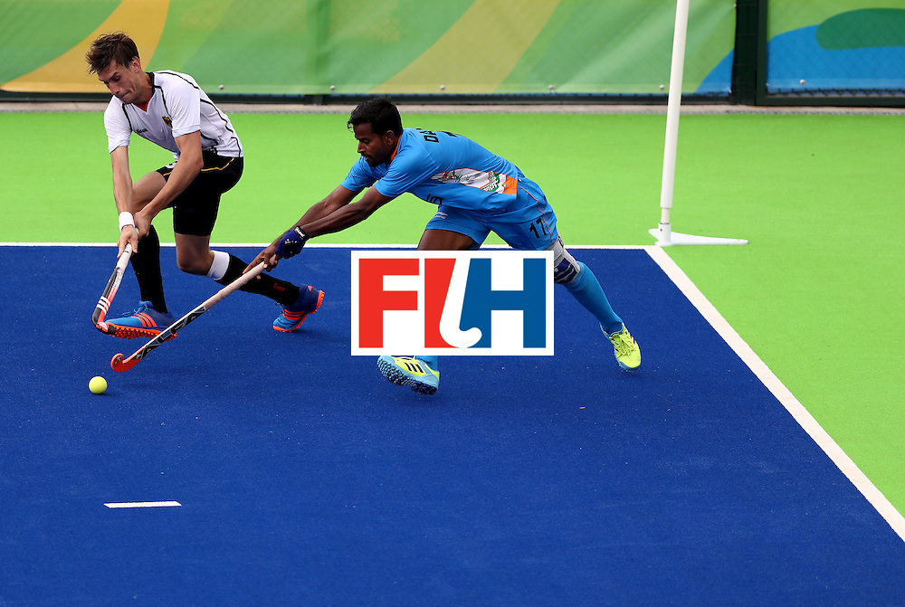 RIO DE JANEIRO, BRAZIL - AUGUST 08:  Florian Fuchs #23 of Germany battles Danish Mujtaba #17 of India for a loose ball during a Men's Pool B match on Day 3 of the Rio 2016 Olympic Games at the Olympic Hockey Centre on August 8, 2016 in Rio de Janeiro, Brazil.  (Photo by Sean Haffey/Getty Images)