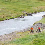 Jökull Bergmann and Sunna Björk Bragadóttir mountain biking at Klængshóll, Skíðadalur, North, Iceland.