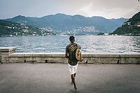 COMO, ITALY - 21 JUNE 2017: Fofana Abdoulaye, a 31-years old migrant fro the Ivory Coast whose fream was to become a politician, is seen here by Lake Como in Como, Italy, on June 21st 2017.<br /> <br /> Residents of Como are worried that funds redirected to migrants deprived the town's handicapped of services and complained that any protest prompted accusations of racism.<br /> <br /> Throughout Italy, run-off mayoral elections on Sunday will be considered bellwethers for upcoming national elections and immigration has again emerged as a burning issue.<br /> <br /> Italy has registered more than 70,000 migrants this year, 27 percent more than it did by this time in 2016, when a record 181,000 migrants arrived. Waves of migrants continue to make the perilous, and often fatal, crossing to southern Italy from Africa, South Asia and the Middle East, seeing Italy as the gateway to Europe.<br /> <br /> While migrants spoke of their appreciation of Italy's humanitarian efforts to save them from the Mediterranean Sea, they also expressed exhaustion with the country's intricate web of permits and papers and European rules that required them to stay in the country that first documented them.