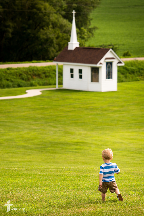 A young boy walks toward the Wayfair Prayer Chapel on Sunday, July 19, 2015, following worship at Mission Central in Mapleton, Iowa. LCMS Communications/Erik M. Lunsford